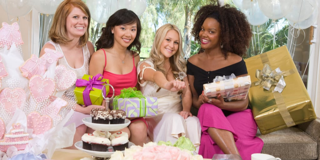 Brides sitting together with her Friends showing engagement ring at Bridal Shower