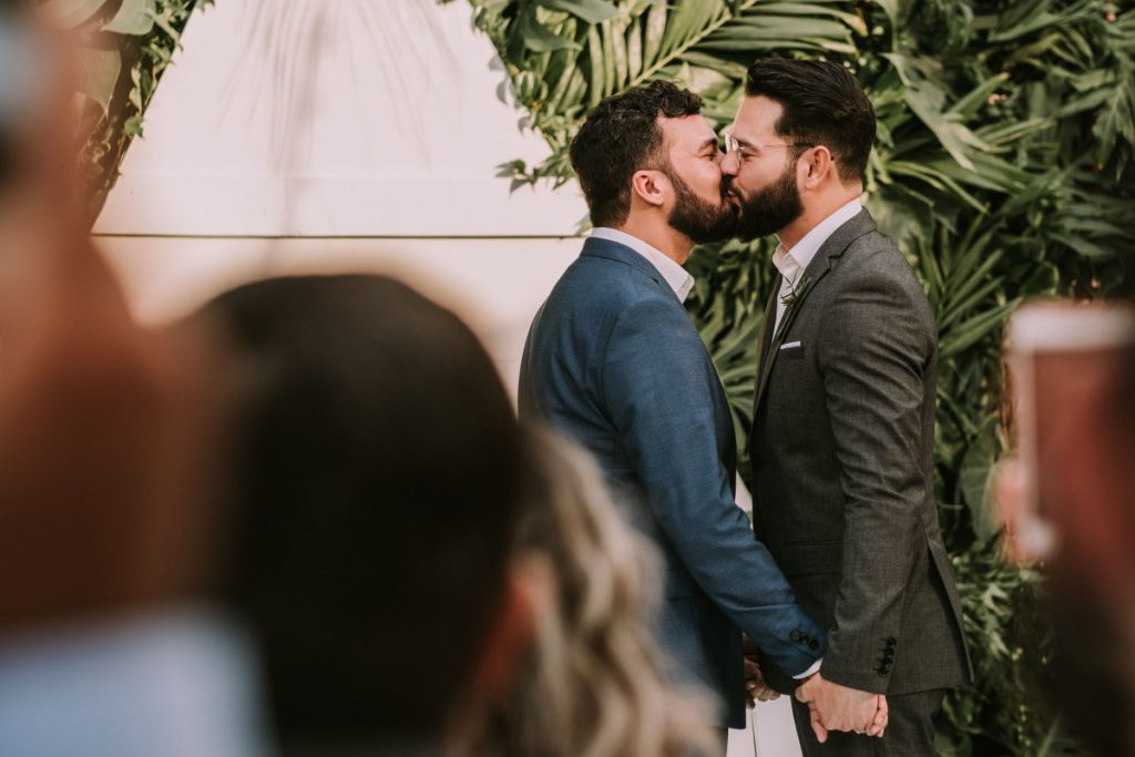 Who walks down the aisle in a gay wedding? Short answer- who ever wants to! Read on for the longer answer & some tips to make you both happy.