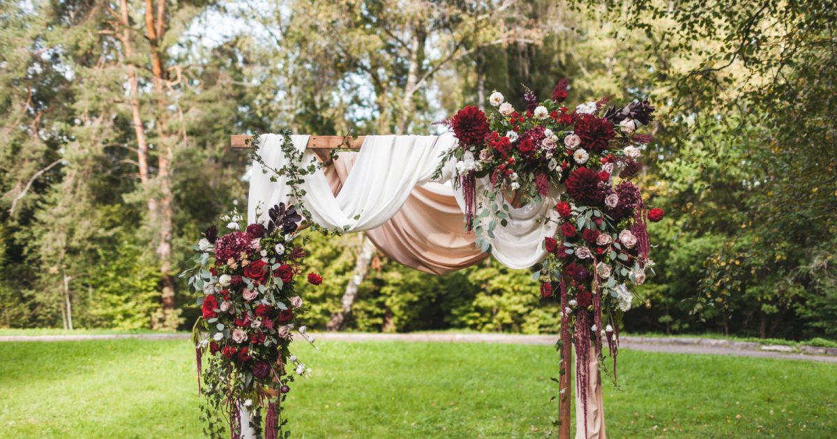 Knowing how to make a floral arch swag for your wedding arch can save you a ton of money. Follow our step-by-step directions for a stunning swag!