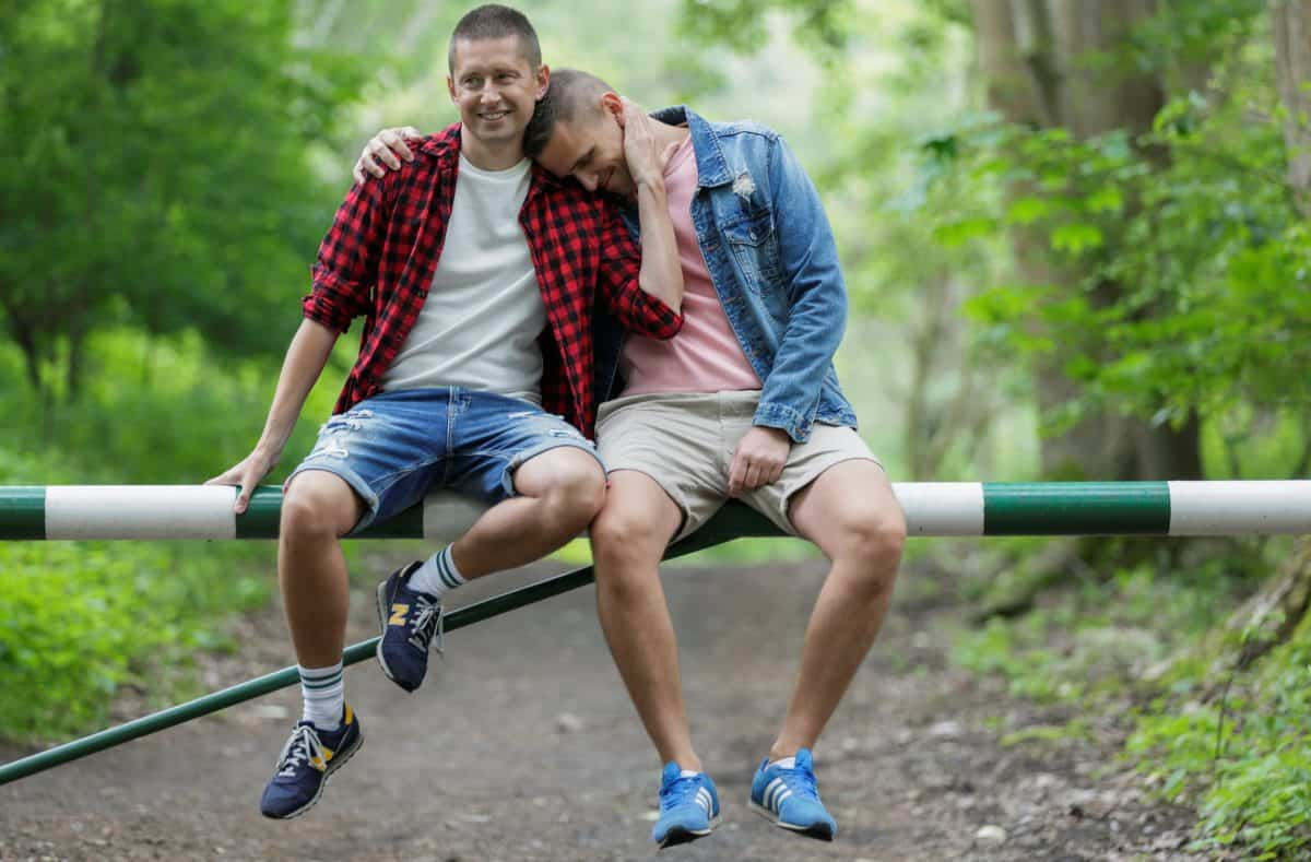 Gay married couple Dawid Mycek (35) and Jakub Kwiecinski (38) embrace as they pose for a photograph in Hel, Poland June 11, 2020. Picture taken June 11, 2020. REUTERS/Matej Leskovsek