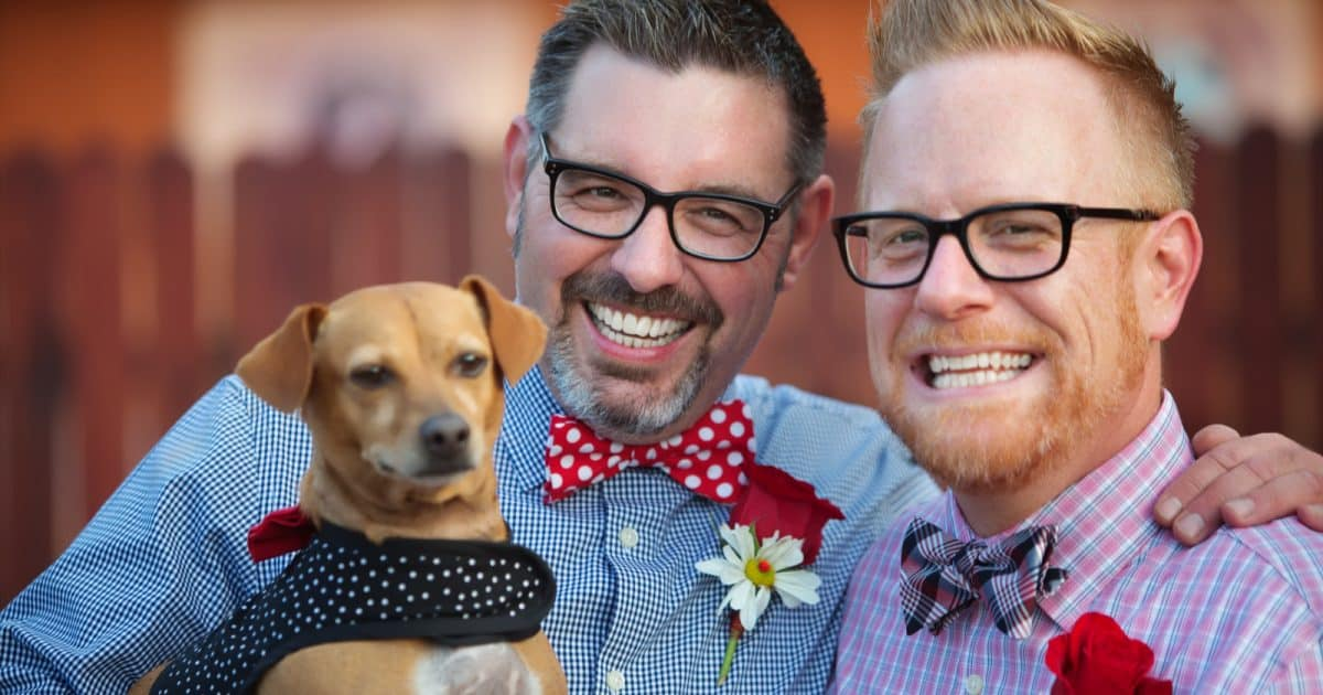two grooms with a dog- non-traditional wedding ideas can include pets