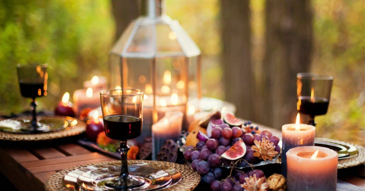 Rustic fall wedding decor with fruits and wine on a table
