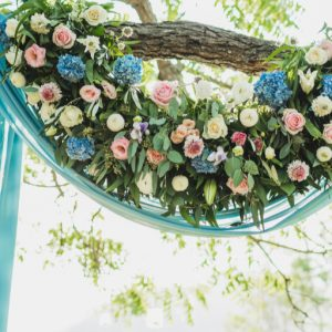 How To Create Epic Wedding Arch Flower Arrangements On A Budget Love You Wedding