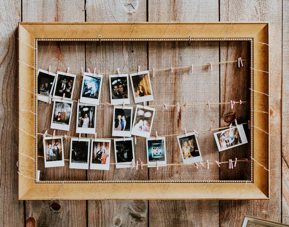 Instant photos of the couple, hung on twine