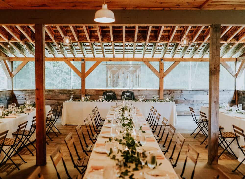Christina + Katrin Lesbian wedding photos- long rustic tables set up for reception
