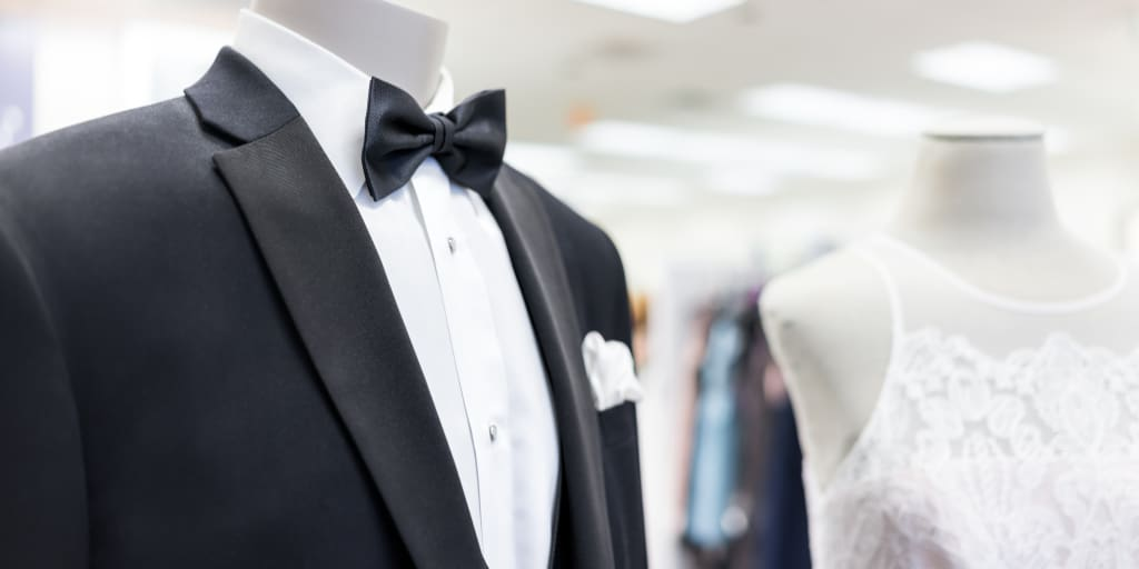 Black and white plus-size women's tuxedo suit on a mannequin