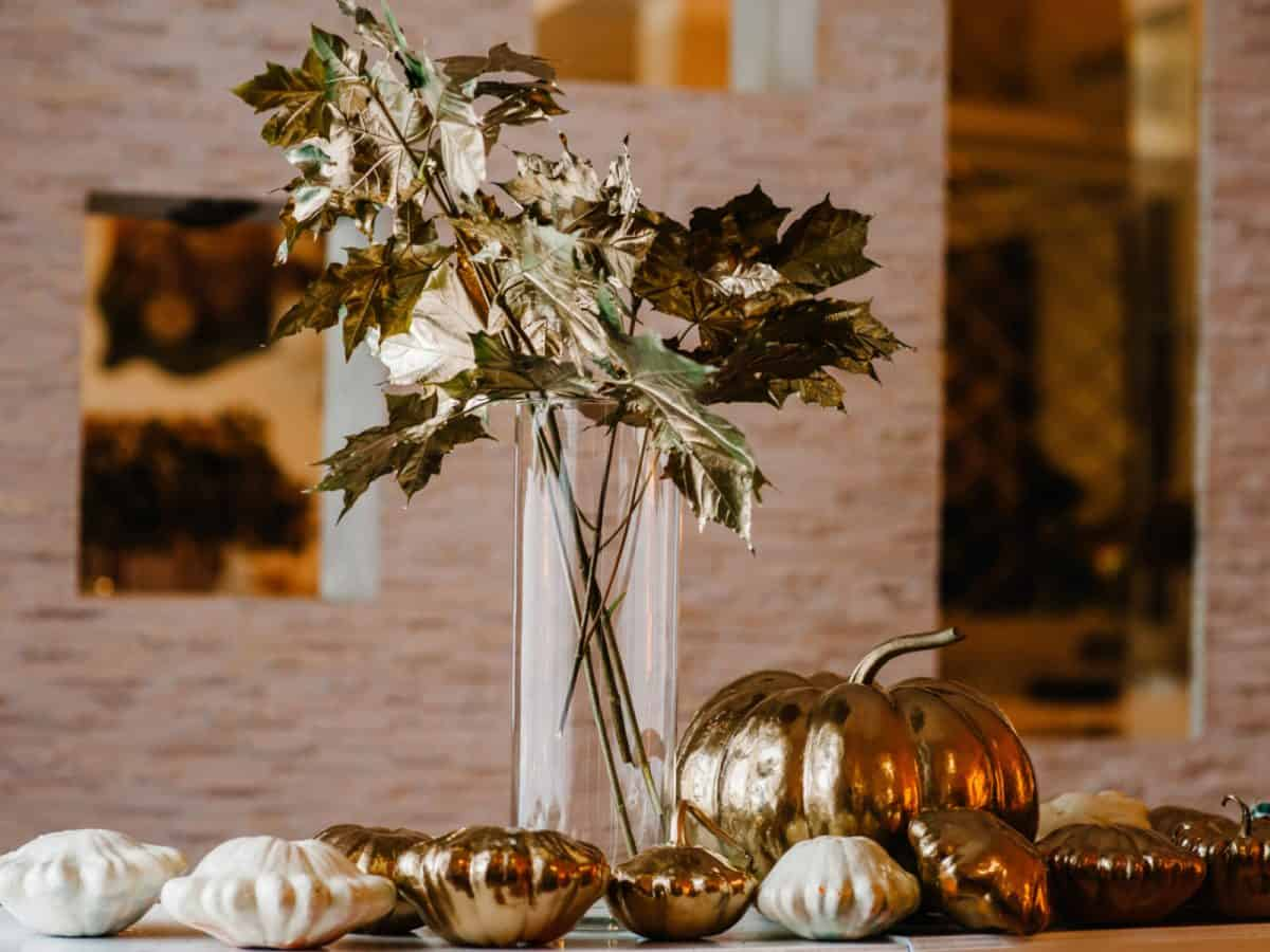 Fall wedding decor, like gold pumpkins and leaves- perfect for your rainbow-free same-sex wedding.