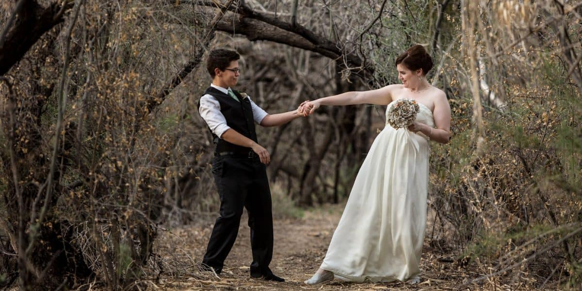 Married same-sex couple dancing to gender-neutral wedding songs.