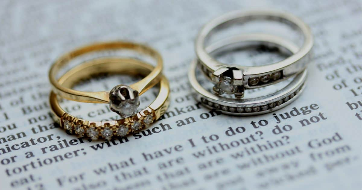 hers and hers wedding rings against a page from a book