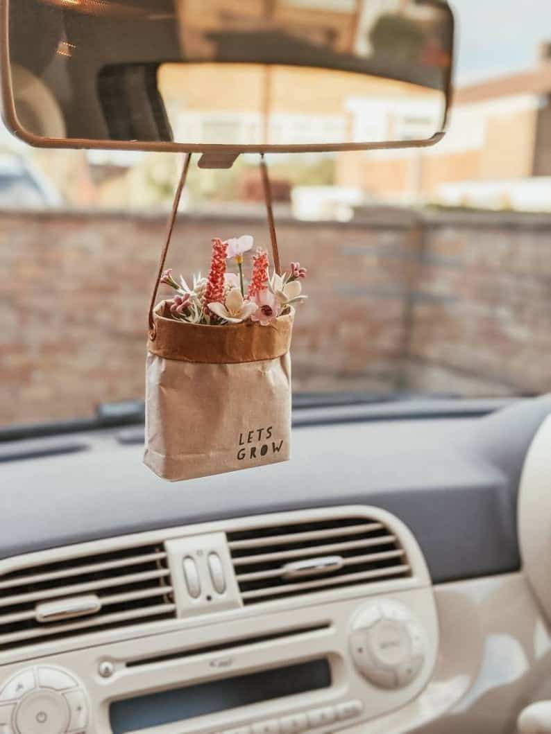 Hanging car decoration with essential oil air freshener.