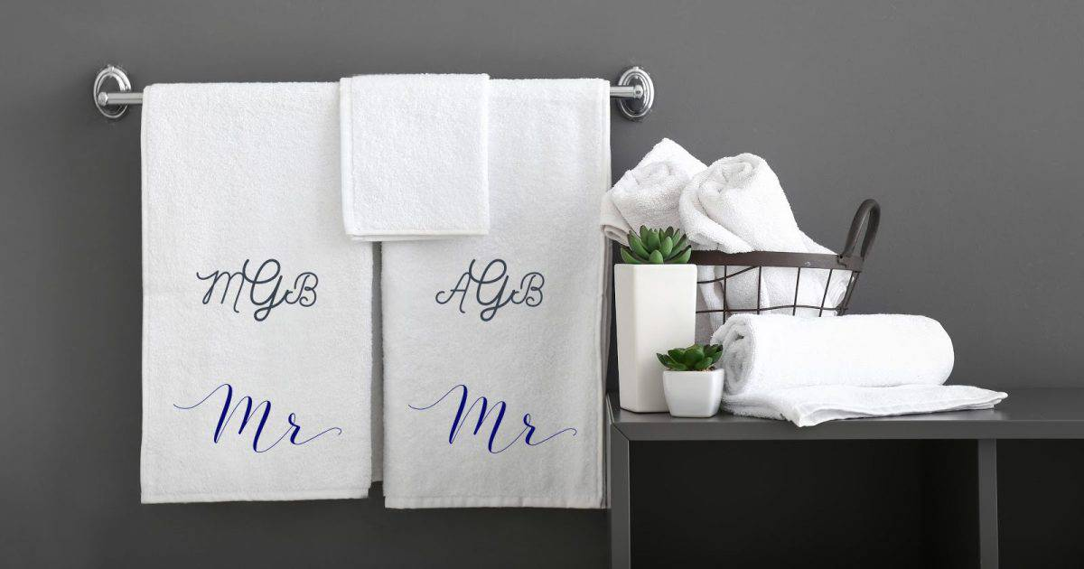 his and his towels monogrammed against a gray wall