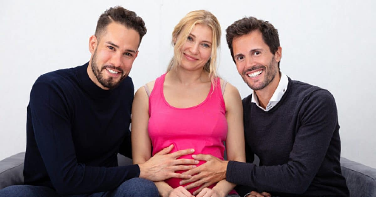 Same-sex parents with their surrogate