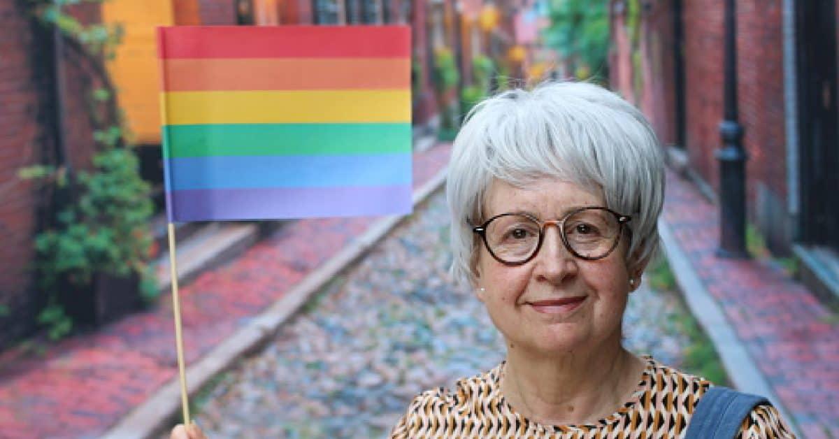 Senior woman waiving the rainbow flag