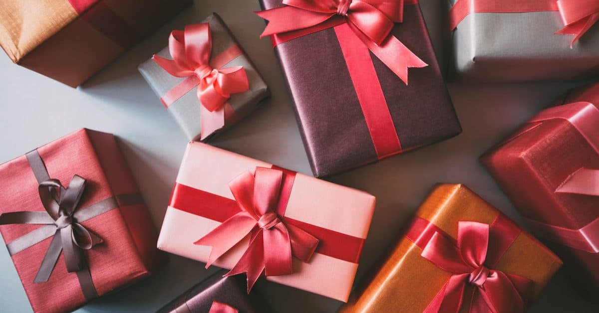 Stylishly packaged boxes with gifts closeup. - Looking for some outstanding anniversary gifts for gay and lesbian couples for their 11th-19th anniversary? Check out our top picks!