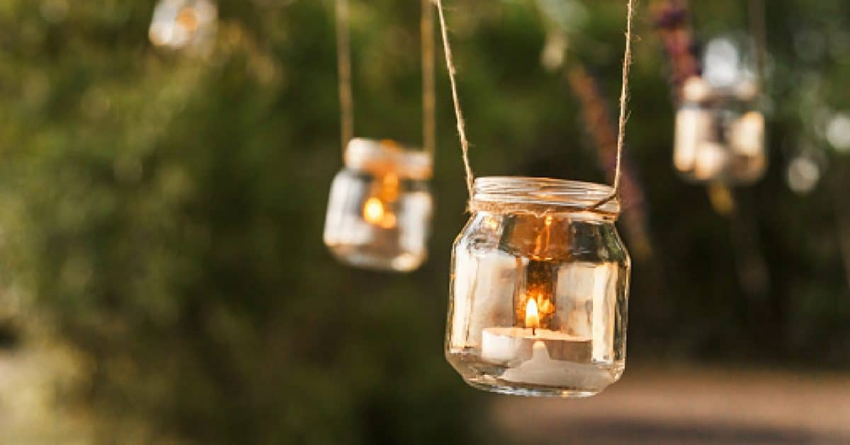 rustic-themed wedding ideas- hang mason jars with candles