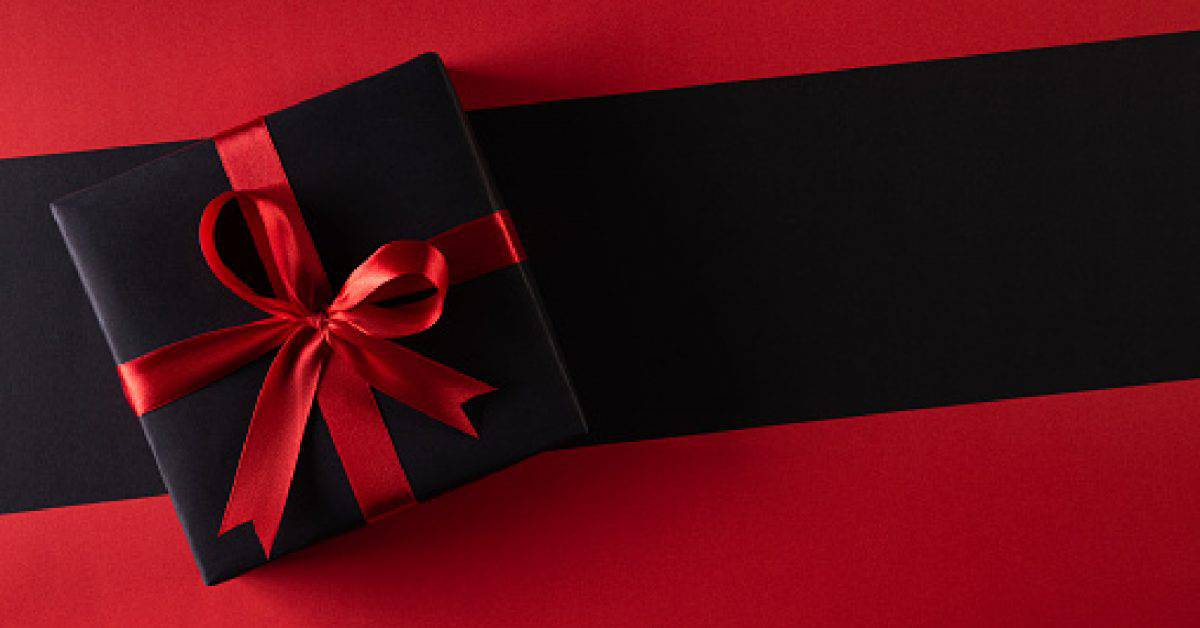 Blue elegant gift box on a wooden background