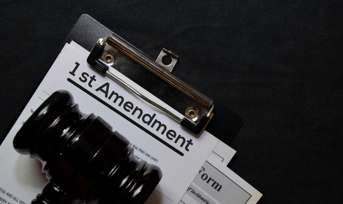 1st Amandment text on Document and gavel isolated on office desk. Hate group lawyer claims laws protecting same-sex couples violates 1st amendment.