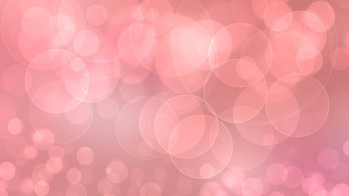 Happy Valentines or wedding day. Abstract delicate love romantic holiday pink gradient orange background with bright bokek circles. Template for cards with space for your design. Beautiful texture
