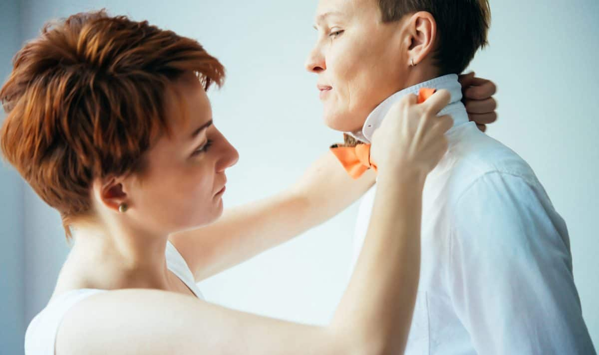 Beautiful lesbian couple is getting ready for their wedding. Gay marriage concept