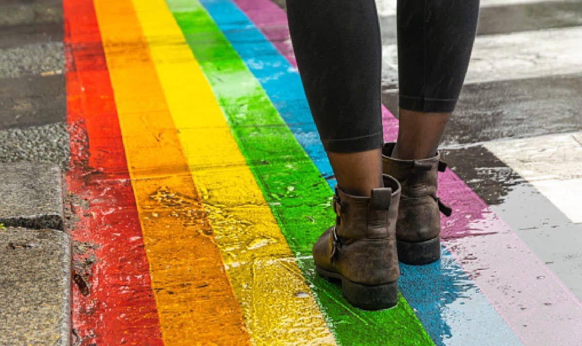 Female legs walking on rainbow crosswalk in Gay parade- Cities Protect Same-Sex Marriage & Other LGBTQ+ Rights Better Than States, HRC Study Shows