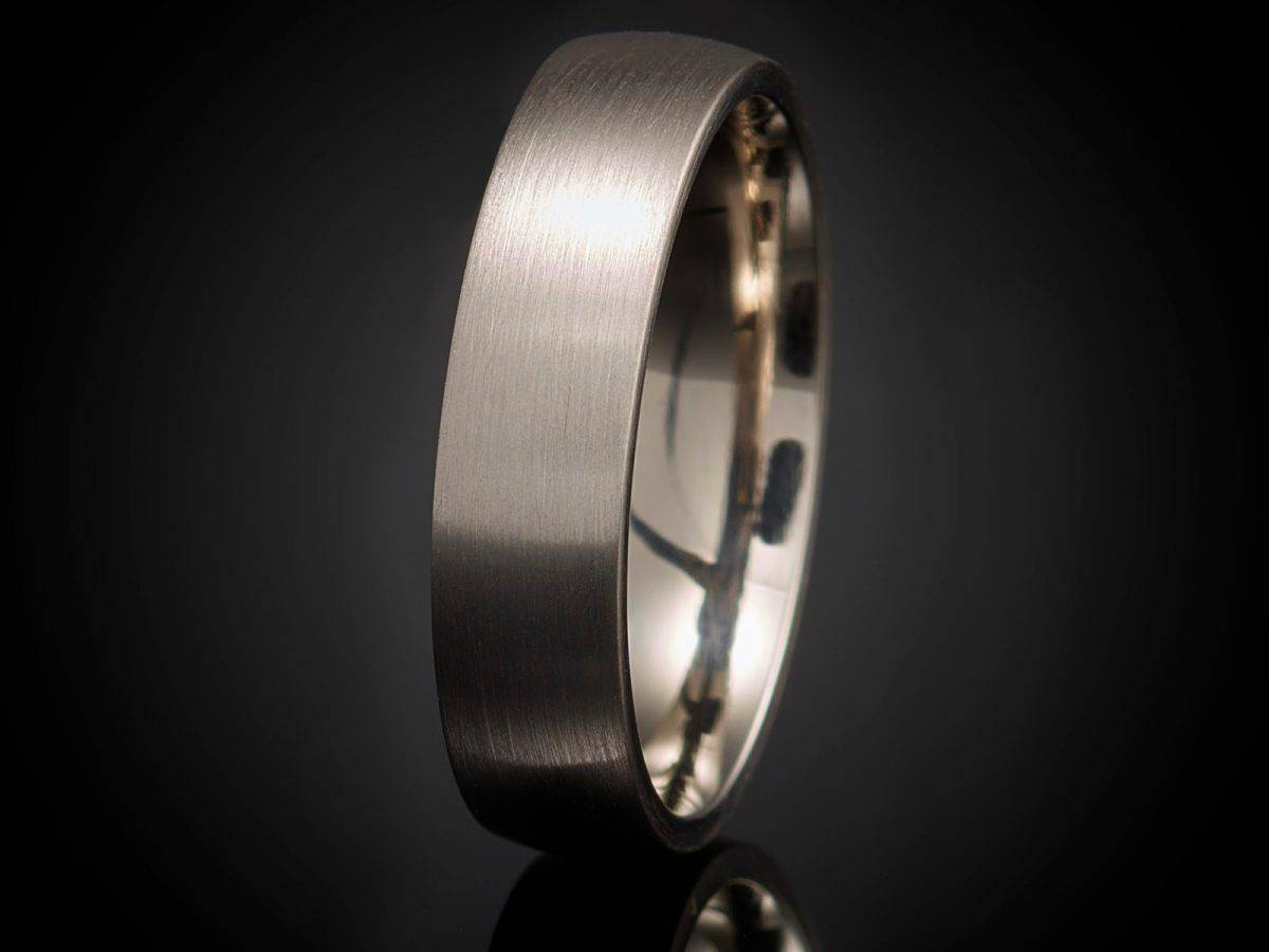 beautiful silver ring isolated on black background.- wedding rings for construction workers.
