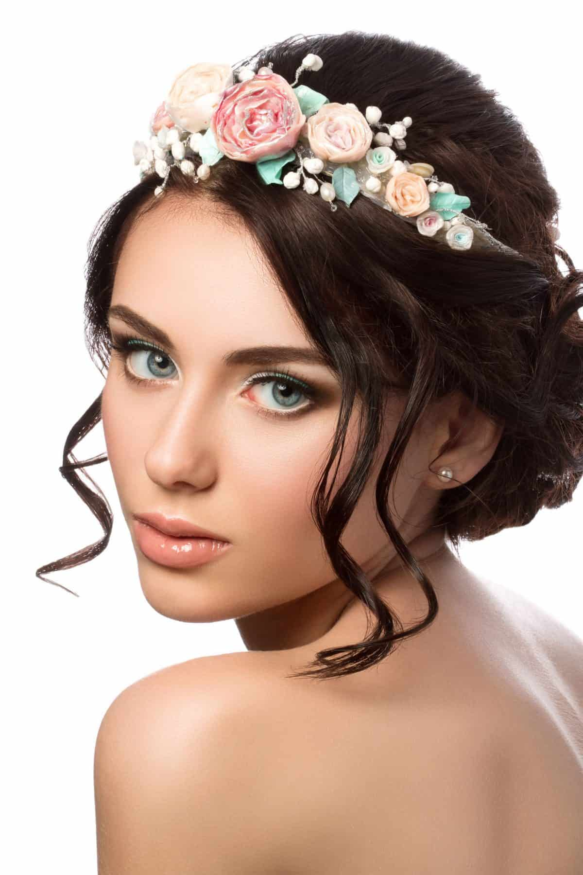 bridal hair. portrait of young beautiful bride. wedding coiffure and make-up.