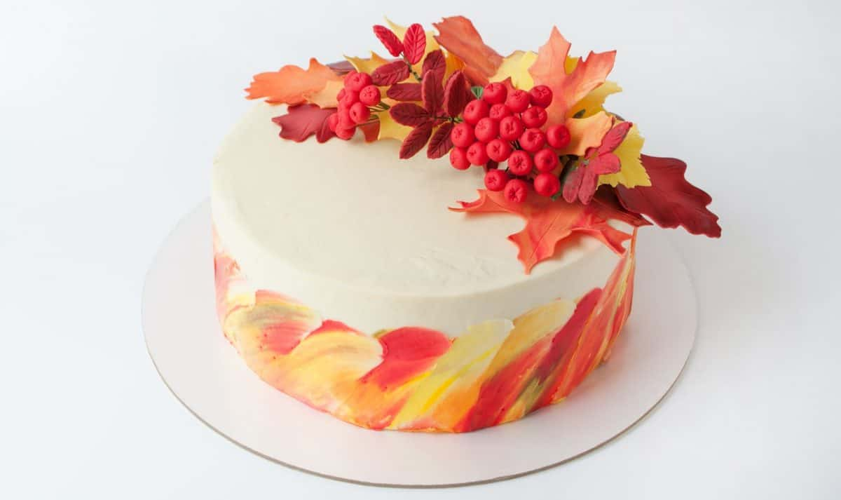 Autumn wedding cake with fondant leaves and colorful icing