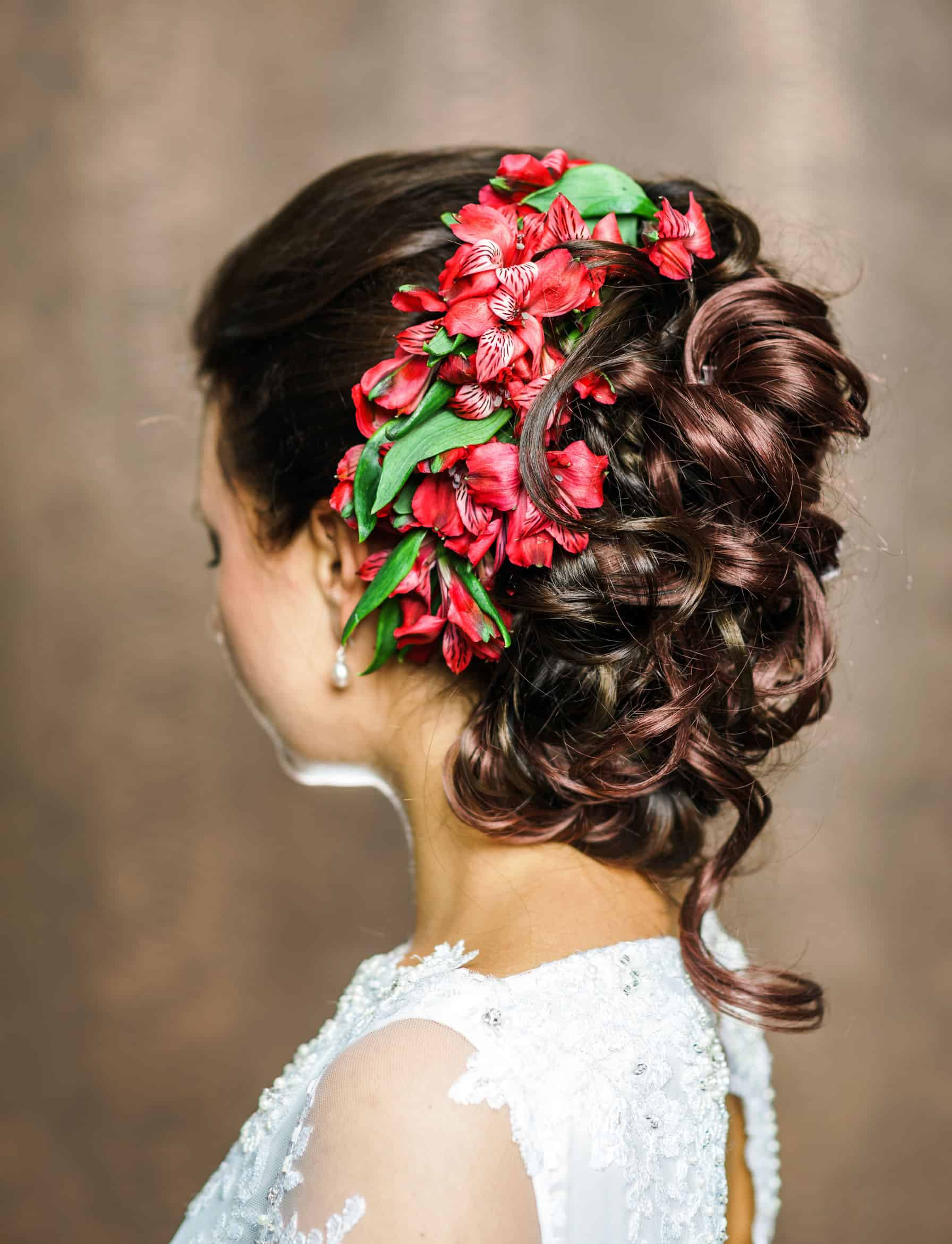 Beautiful bride with fashion wedding hairdress isolated