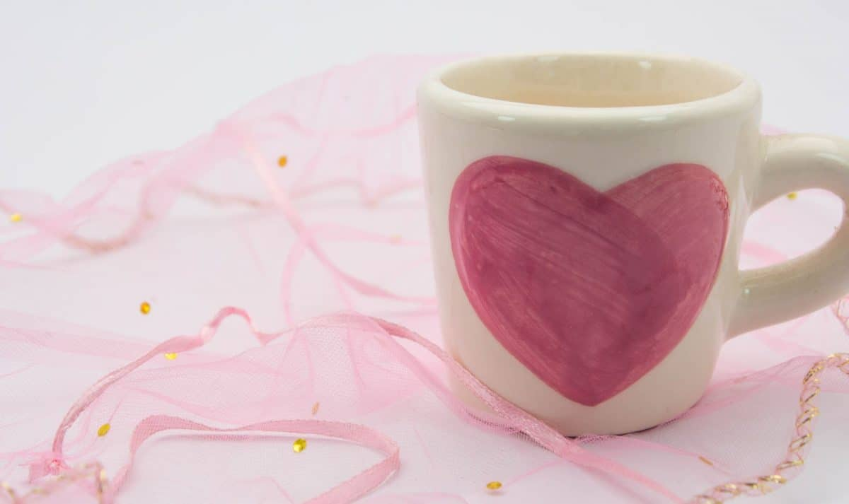 Painted heart-shaped cups placed on the fabric