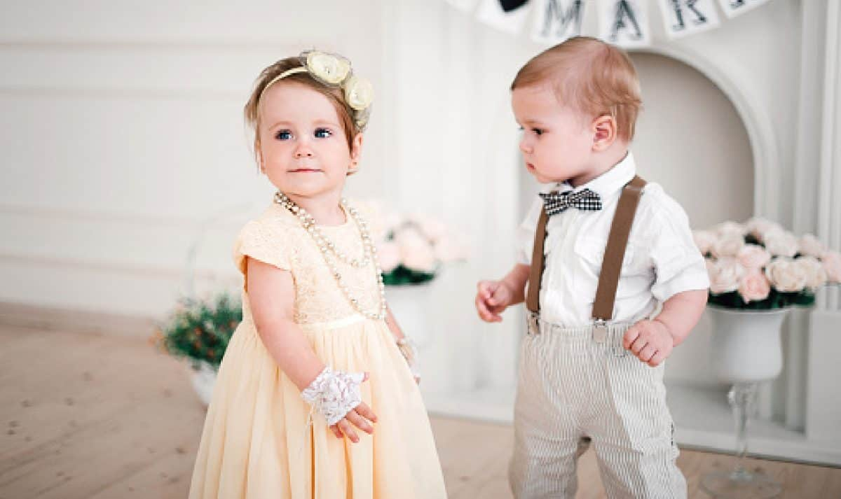 Little boy in suit and girl in dress at a wedding.