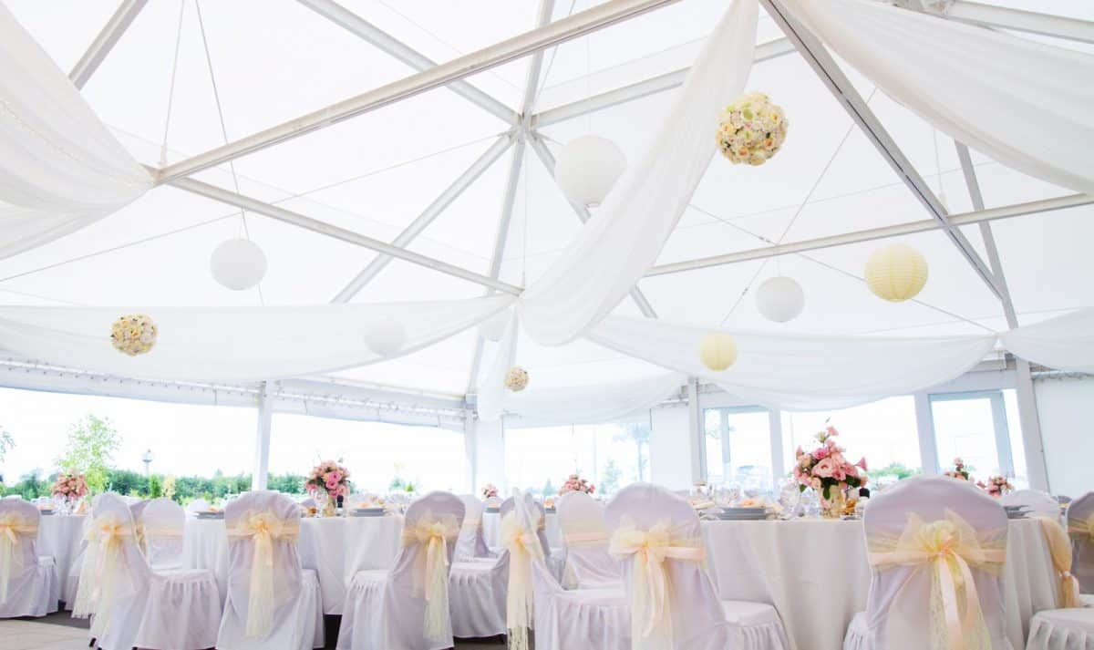 an image of tables setting at a luxury wedding hall