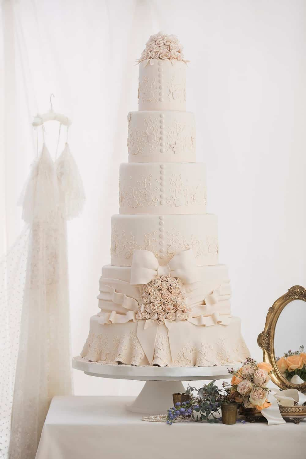 Delicious white wedding cake inspired by the bride's wedding gown.