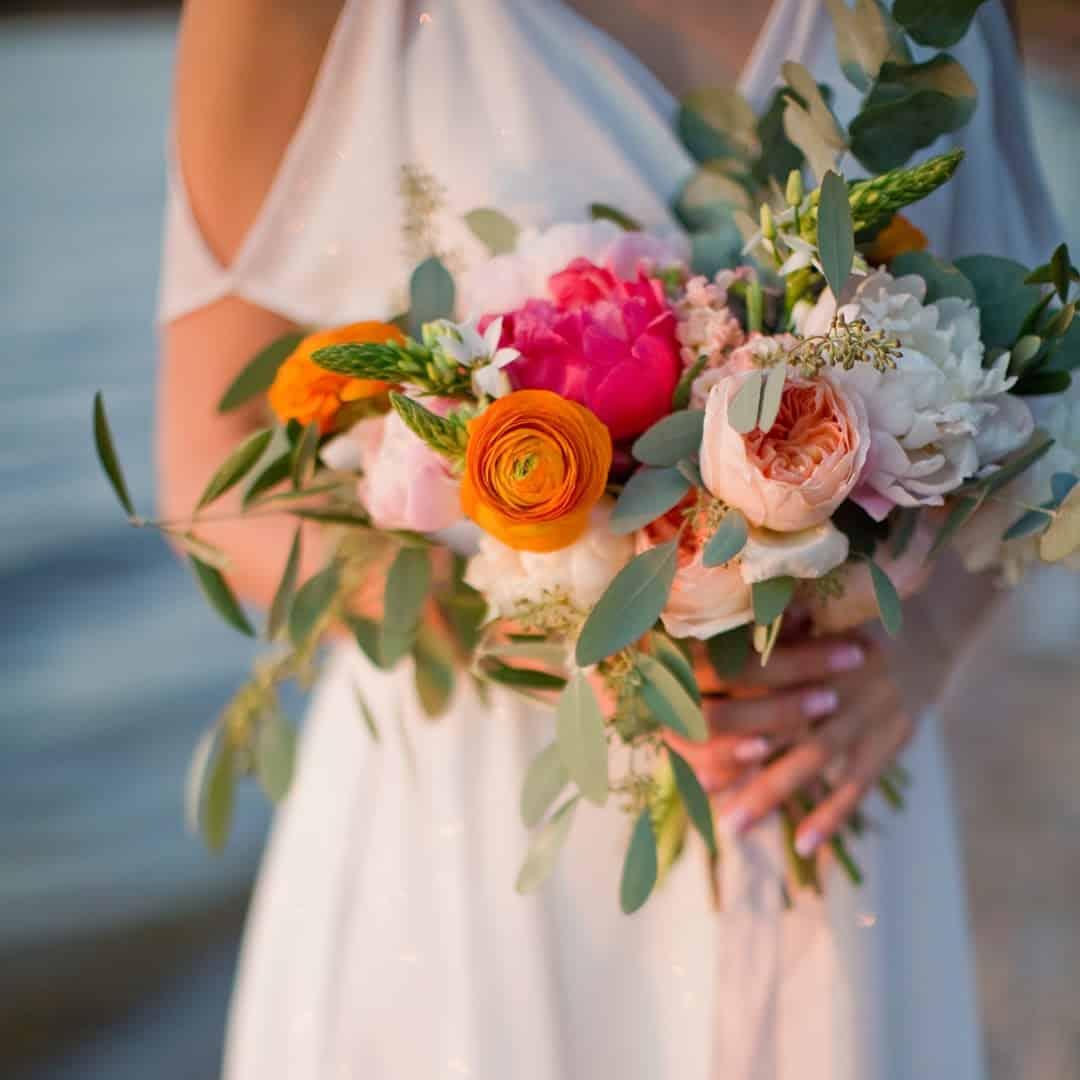 Peony - large orange - red flowers Ranunculus - white closed flowers;