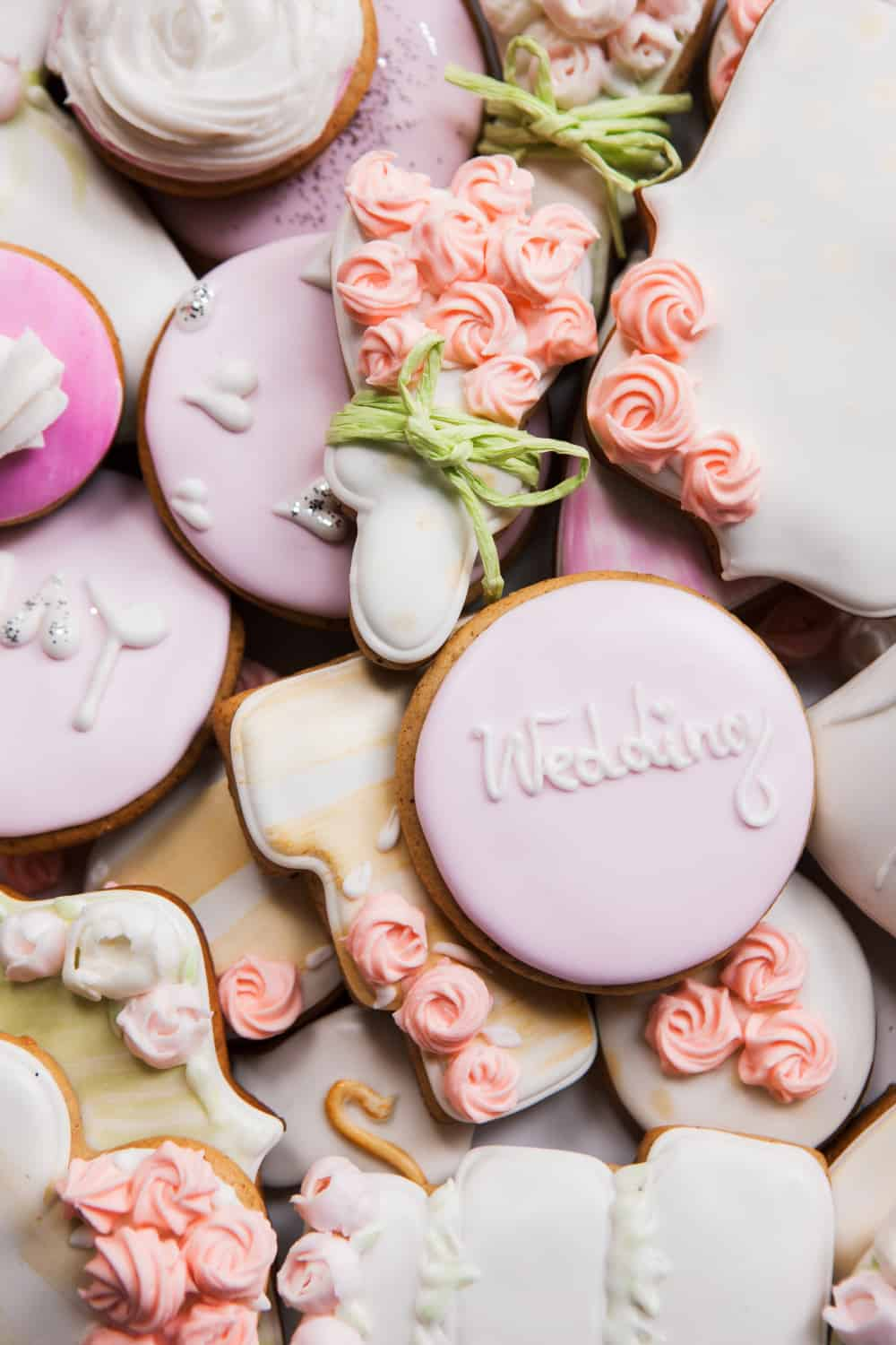 Wedding cookies in different shapes and colors make great unconventional wedding cakes.