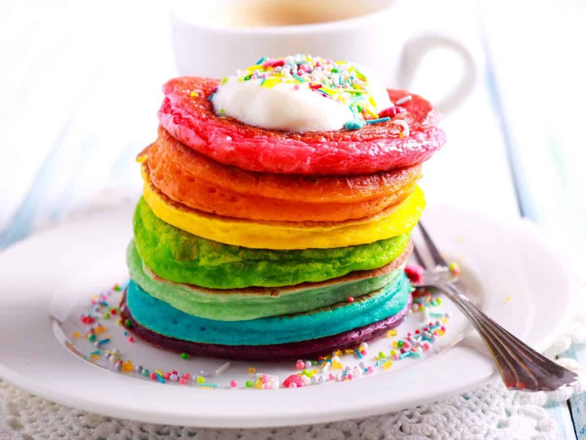 Rainbow pancakes for a gay wedding, served in pile on plate