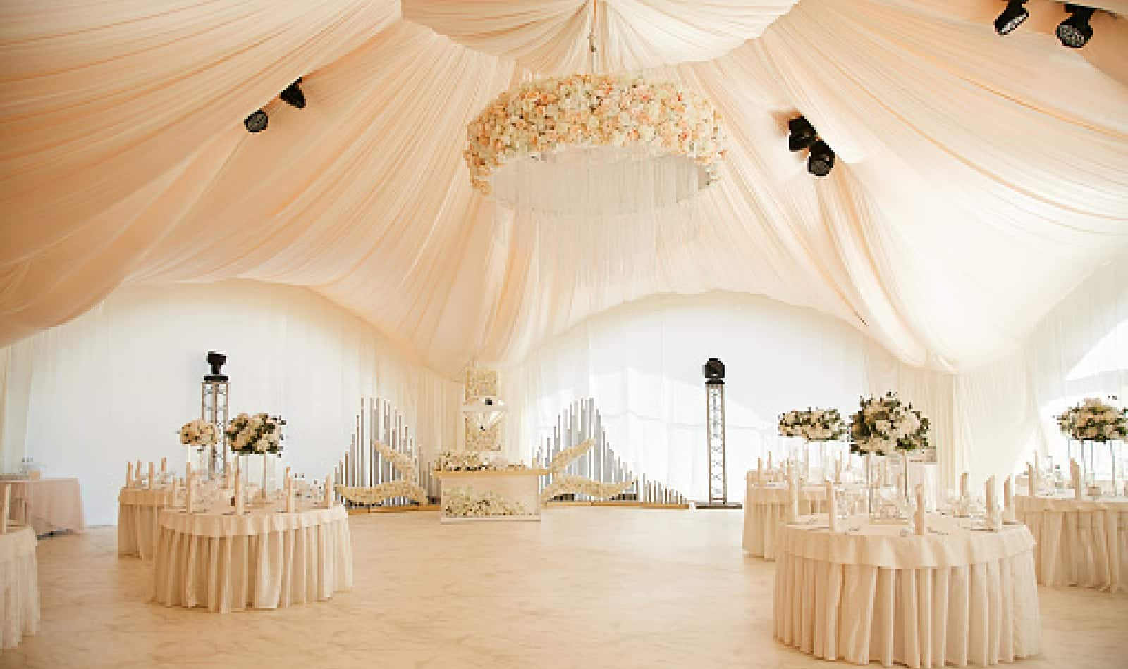 Luxurious high tent decorated for wedding celebration