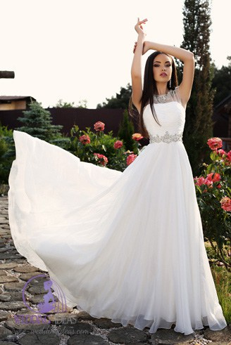 A white wedding dress with a straight bust but the upper bust is made of a net material