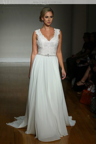 A modest white gown with flowery spaghetti straps. It barely touches the ground.