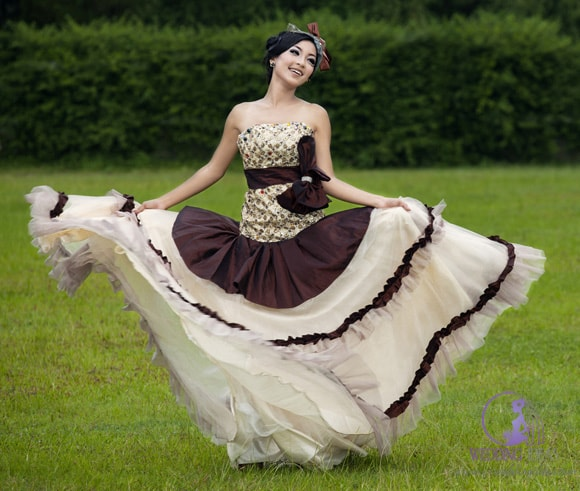 Woman wearing a boho wedding dress with brown accents