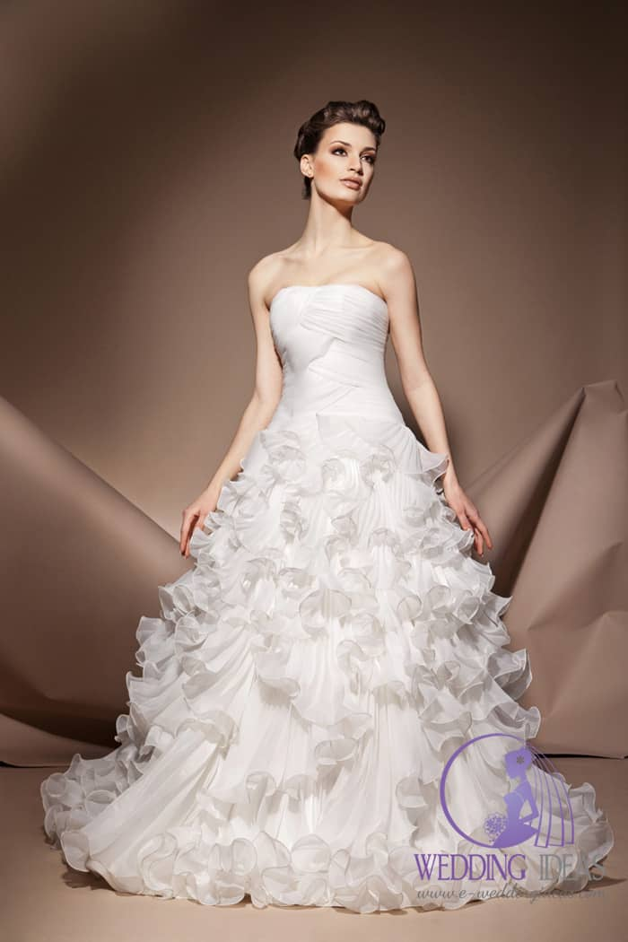 Ball gown with straight necklace and ruffled tulle skirt.