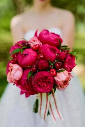 A magnificent wedding bouquet made of round and pink and green leafy flowers