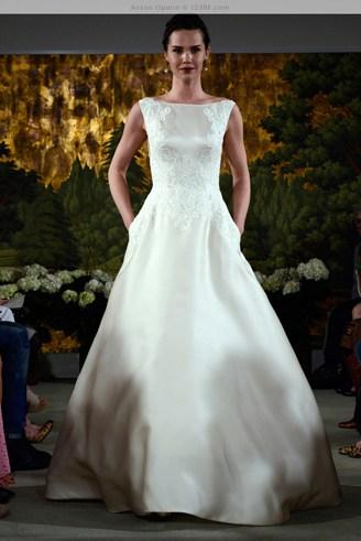 A white dress with a bateau-shaped bust and has some pockets