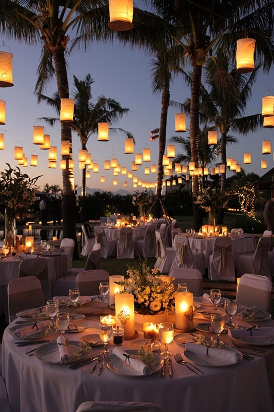 lanterns hanging over wedding tables