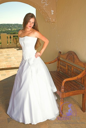 A white bridal gown with a sweetheart-shaped bust