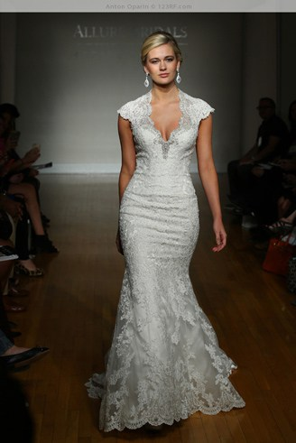 A grey, mermaid-shaped dress with spaghetti straps