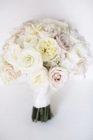 A cool wedding bouquet comprised of white and pale purple flowers