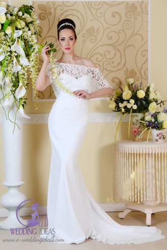 A white wedding dress with a jewel-shaped bust.