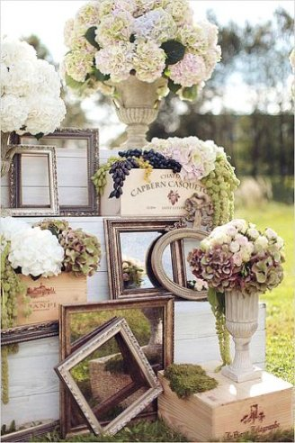Bouquets of white and green flowers put in white jars