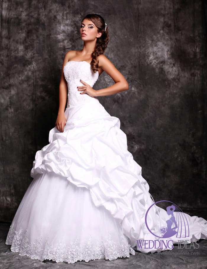 Ball wedding gown with straight necklace, layered on the bodice and smooth belt in the waist.