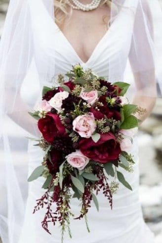 Roses - bright pink flowers; Peony - large red flowers; Salal Leaves - leaves on the right side bouquets at the top; Dhalia